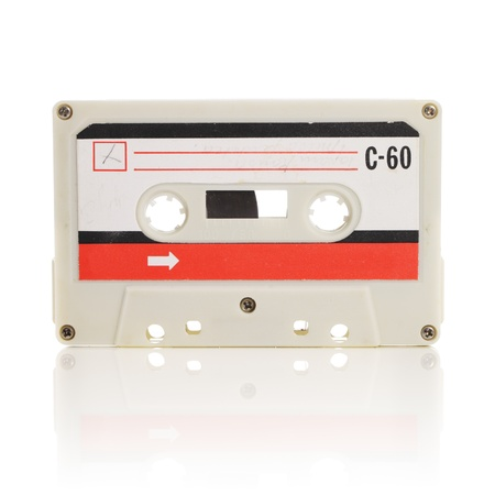 Old compact cassette audio tape isolated on white 