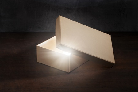 Mysterious old shoe box with glowing contents. photo