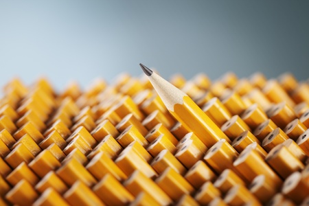 sharpen: Sharpened pencil amongst the non-sharpened ones.