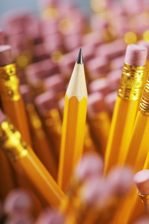 A Sharp pencil among pencil erasers. Stock Photo - 12247652