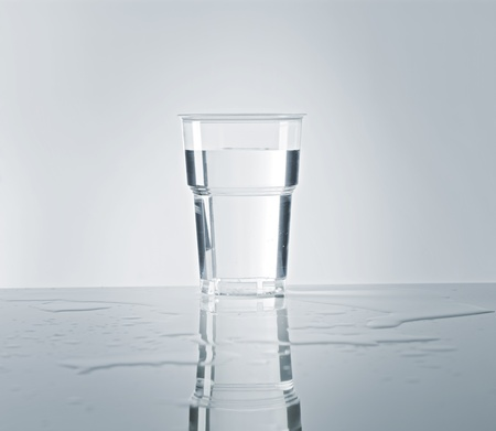 reflects: A Disposable plastic cup filled with water.