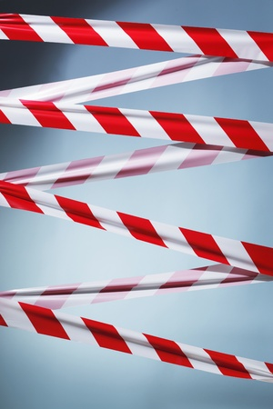 blocking: Red and white plastic barrier tape blocking the way. Stock Photo