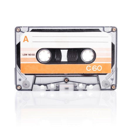 Old compact cassette audio tape isolated on white with natural shadow. Stock Photo - 12713377