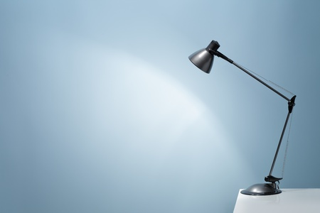 An office desk lamp illuminating the background. Lots of copy space. Stock Photo - 12713387
