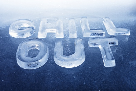 Words Chill Out made of real ice letters on ice background. Stock Photo