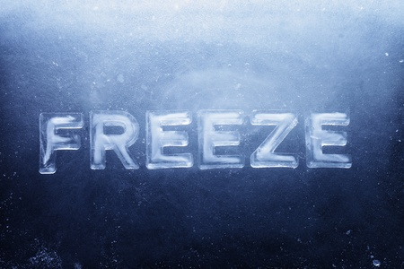 Word Freeze made of letters made of real ice. Фото со стока