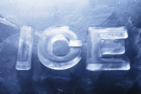Word ICE made with real ice letters on ice.