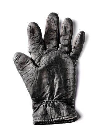 old leather: Old worn black leather glove isolated on white with natural shadow.