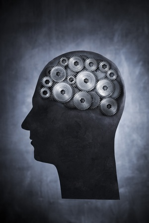 Conceptual image of head filled with cog gears. Stock Photo - 12956461