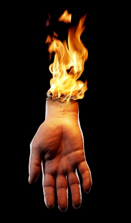 A Bizarre burning hand on black background. Stock Photo - 12956178