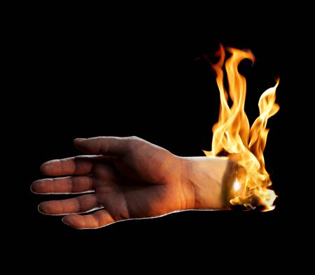 A Burning hand on black background. Stock Photo - 12956068