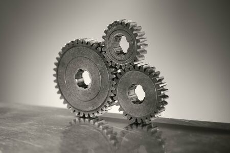 Monochrome still life of three old cog gear wheels. Short depth-of-field. Stock Photo - 12956432