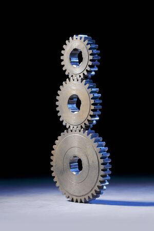 Still life with three cog gear wheels stacked on eachother. Stock Photo - 12956328