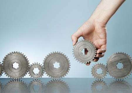 gears: Man het toevoegen van een radertje versnelling in een rij van oude tandwiel tandwielen.