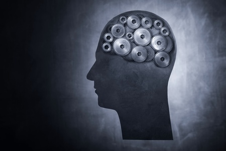 Conceptual image of head filled with cog gears. photo
