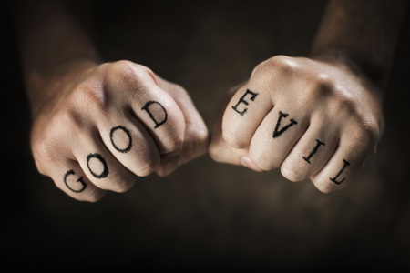 Man with Good and Evil fake tattoos. Stock Photo