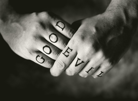 moral: Man with Good and Evil (fake) tattoos on his fingers.