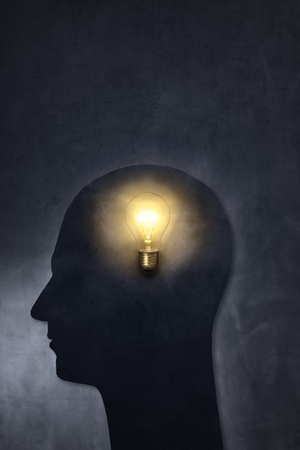 Artistic silhouette of a head with a bulb. photo