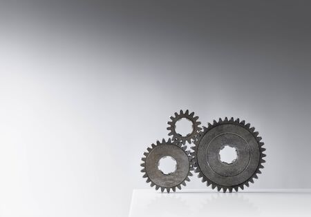 toothed: Still life with three old cog gears. Lots of copy space. Stock Photo