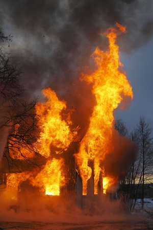 A Wooden house in flames Stock Photo - 13471917