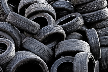 Pile of old used car tires. photo