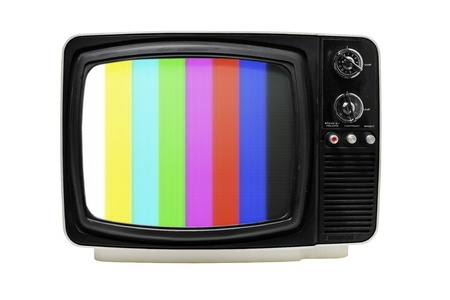 television: Old 12 portable television with color bars test image. Stock Photo