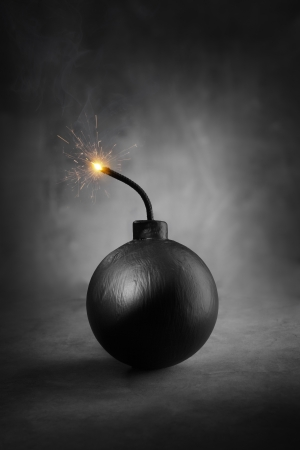 A Cartoon-style round black bomb with a burning fuse. Stock Photo