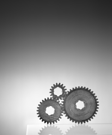 gearwheel: Black and white photograph of three old cog gear wheels. Stock Photo