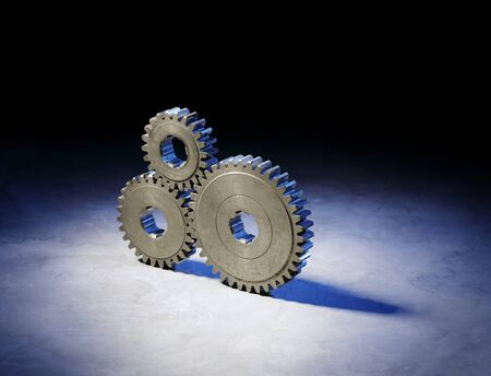 cog gear: Still life with three old metallic cog gear wheels. Stock Photo
