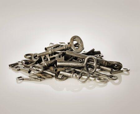 old keys: A Pile of old metallic keys.