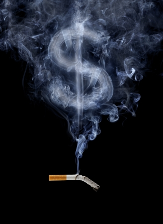 Cigarette with smoke shaped like a dollar sign. photo