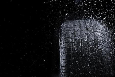 New car tire in rain.