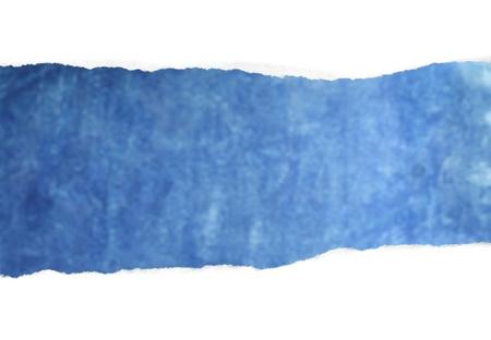 reveals: A Torn white paper reveals blue background.