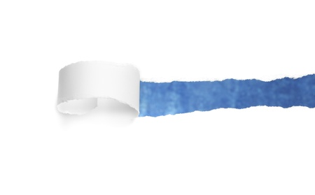 White torn paper revealing blue background.