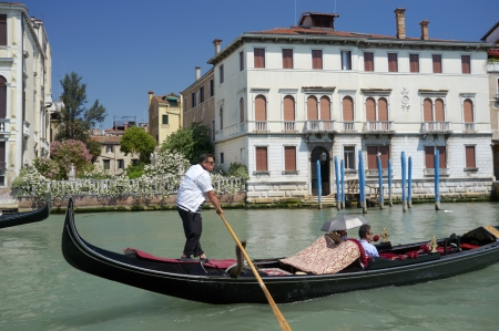 VENICE, VENETO, ITALY - CIRCA MAY 2011: Gondolier with his gondola on Grand Canal. circa May 2011 in Venice, Veneto, Italy Stock Photo - 14146142