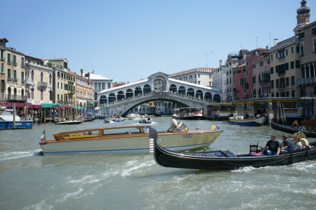 Venice, Veneto, Italy - May 25: The Grand Canal is a canal in Venice, Italy. It forms one of the major water-traffic corridors in the city. Public transport is provided by water buses and private water taxis, and many tourists explore the canal by gondola Stock Photo - 14146120