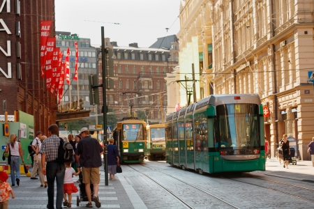 HELSINKI, FINLAND - CIRCA 2006: Typical Helsinki streew view with pedestrians and trams. circa 2006 in HELSINKI,  Finland