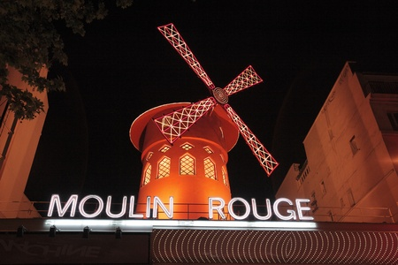 moulin: PARIS, FRANCE - MAY 17: Red windmill of famous nightclub Moulin Rouge May 17, 2010 in Paris, France Editorial