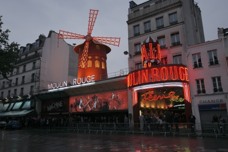 moulin: PARIS, FRANCE - MAY 17: Exterior of famous nightclub Moulin Rouge May 17, 2010 in Paris, France Editorial