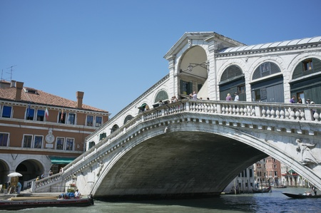 VENICE, VENETO, ITALY - MAY 24, 2011: Famous Rialto bridge on Grand Canal. May 24, 2011 in Venice, Veneto, Italy Stock Photo - 14146110
