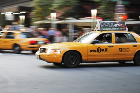 NEW YORK CITY, USA - JUNE 8: Yellow New York taxi cab driving on a street. June 8, 2012 in New York City, USA