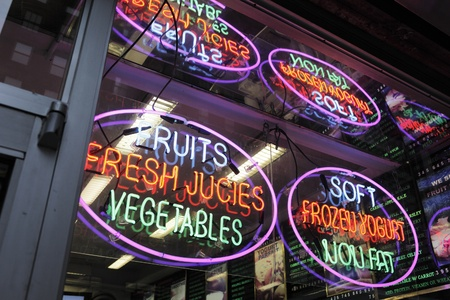 advertize: NEW YORK CITY, USA - JUNE 9: Neon signs in a deli window. June 9, 2012 in New York City, USA