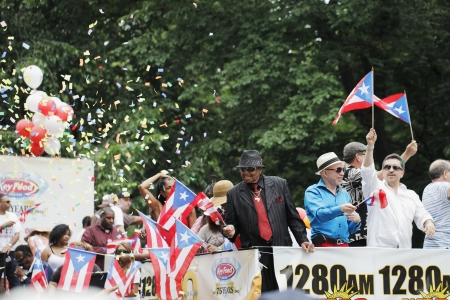 onboard: NEW YORK CITY, USA - JUNE 10: The annual Puerto Rican Day Parade in NYC honoring the inhabitants of Puerto Rico and all people of Puerto Rican birth or heritage. June 10, 2012 in New York City, USA