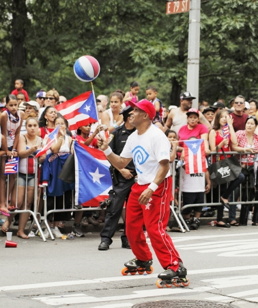 puerto rican flag: NEW YORK CITY, USA - JUNE 10: The annual Puerto Rican Day Parade in NYC honoring the inhabitants of Puerto Rico and all people of Puerto Rican birth or heritage. June 10, 2012 in New York City, USA