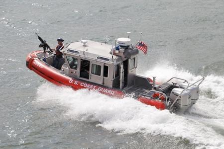 coast guard: NEW YORK CITY, USA - JUNE 10: U.S. Coast Guard boat on Upper New York Bay. June 10, 2012 in New York City, USA