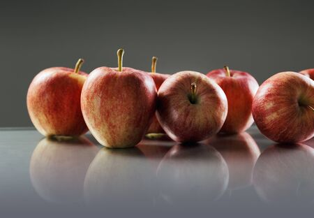 Red Apples on reflective surface. Stock Photo - 14267772