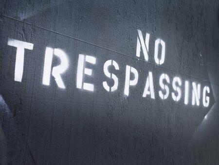 trespassing: Text  No Trespassing  sprayed on a wall