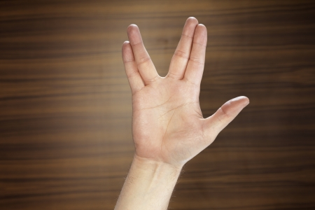 Man making a Vulcan Salute with his hand. photo