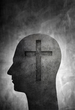 theology: Conceptual image of a head with a christian cross symbol. Stock Photo