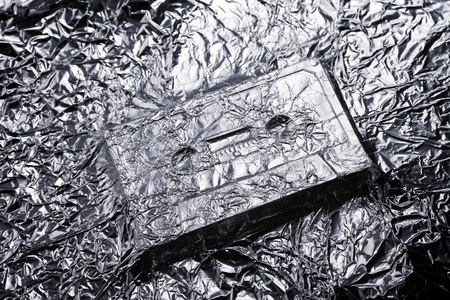 Audio compact cassette covered with aluminium foil. Stock Photo - 15472662